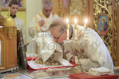 Fr. Daniel Gurovich kisses the bread and wine during the consecration at St. Josaphat Ukrainian Catholic Church in Bethlehem, PA. photo/Don Blake Photography