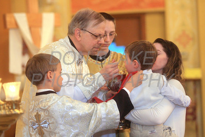Fr. Daniel Gurovich distributes Holy Communion to communicants with a spoon at St. Josaphat Ukrainian Catholic Church in Bethlehem, PA. photo/Don Blake Photography