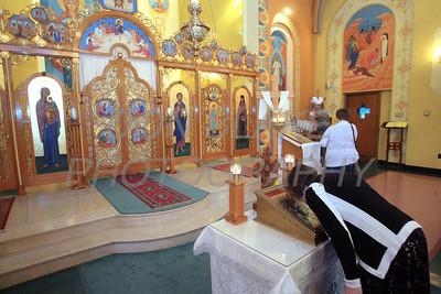 A woman kisses the tetrapod after mass at St. Josaphat Ukrainian Catholic Church in Bethlehem, PA. photo/Don Blake Photography