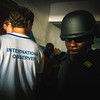Monrovia, Liberia October 10, 2017 -  Liberian police make their way through a hallway at a polling station on election day.