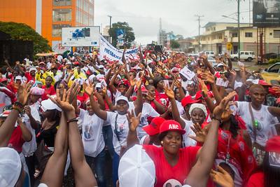 Monrovia, Liberia October 7, 2017 -  Supporters parade through rain soaked streets prior to the 2017 election.
