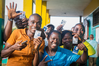 Monrovia, Liberia October 10, 2017 -  Voters display their voter cards on election day.
