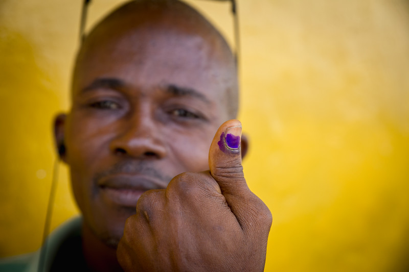 Monrovia, Liberia October 10, 2017 -  A man shows he voted on election day.