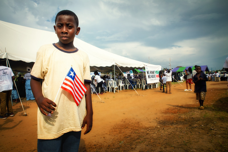 Monrovia, Liberia October 9, 2017 -  A young boy holds a Liberian flag outside of the women's prayer tent.