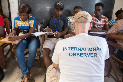 Monrovia, Liberia October 10, 2017 -  Nick Jahr speaks with election observers at a polling station on election day.