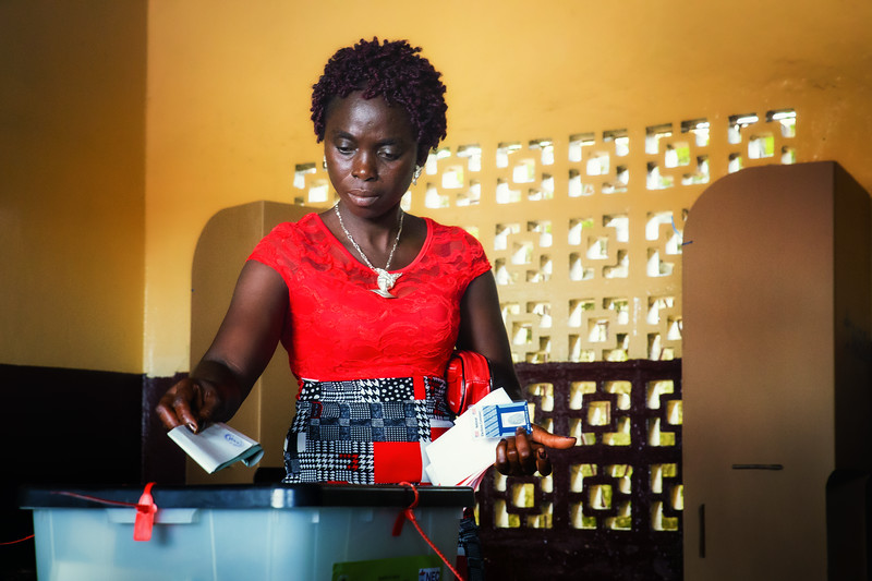 Monrovia, Liberia October 10, 2017 - A woman votes at a polling station on election day.