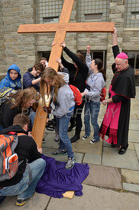 Bishop Malooly helps members of St. John the Beloved Parish place the cross into the stand at St. Anthony of Padua Parish in Wilmington, Del., during the 2012 Cross Pilgrimage March 31, 2012. photo/ www.DonBlakePhotography.com