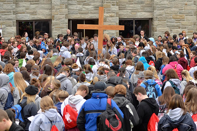 All gather around the cross and pray at St. Anthony of Padua Parish in Wilmington, Del., during the 2012 Cross Pilgrimage March 31, 2012. photo/ www.DonBlakePhotography.com