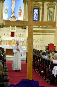 Bishop Malooly talks before the Eucharistic Adoration at St. Paul Church in Wilmington, Del., during the 2012 Cross Pilgrimage March 31, 2012. photo/ www.DonBlakePhotography.com
