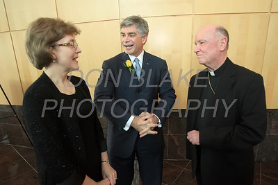 Richelle Vible, Executive Director, Dr. Patrick Harker, President of the University of Delaware at the 2012 Msgr. Thomas J. Reese Award recipient and Bishop Malooly talk during the Annual Tribute Dinner, Wednesday, March 28, 2012. photo/ www.DonBlakePhotography.com