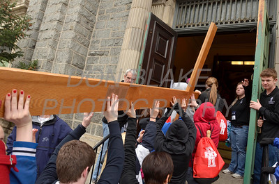 A cross is turned sideways to fit in door at St. Paul Church in Wilmington, Del., during the 2012 Cross Pilgrimage March 31, 2012. photo/ www.DonBlakePhotography.com