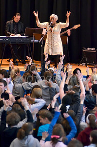 Participants dance and sing as Singer, ValLimar Jansen sings during the concert at St. Anthony of Padua Parish in Wilmington, Del., during the 2012 Cross Pilgrimage March 31, 2012. photo/ www.DonBlakePhotography.com