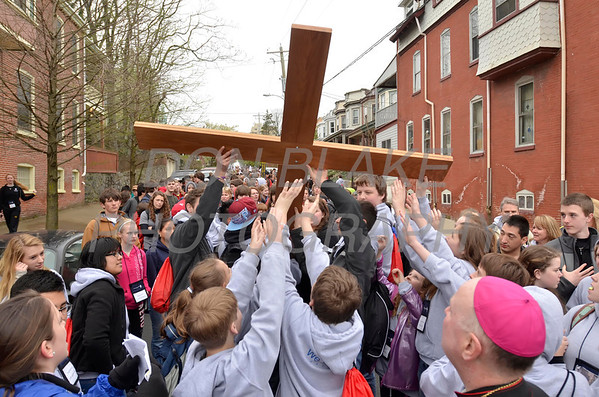 A new group prepare to carry the cross on 9th Street in Wilmington, Del., during the 2012 Cross Pilgrimage March 31, 2012. photo/ www.DonBlakePhotography.com