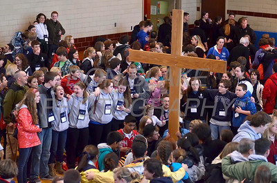 Participants sing as they gather aroung the cross in reflection at St. Anthony of Padua Parish in Wilmington, Del., during the 2012 Cross Pilgrimage March 31, 2012. photo/ www.DonBlakePhotography.com