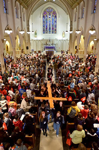 The cross is carried out of St. Thomas the Apostle Church during the 2012 Cross Pilgrimage March 31, 2012. photo/ www.DonBlakePhotography.com