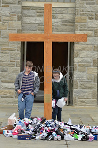 Donated shoes are place at the foot of the cross at St. Anthony of Padua Parish in Wilmington, Del., during the 2012 Cross Pilgrimage March 31, 2012. photo/ www.DonBlakePhotography.com