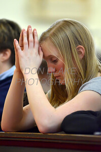 Victoria Gotthold of St. Joseph Parish prays during Eucharistic Adoration at St. Paul Church in Wilmington, Del., during the 2012 Cross Pilgrimage March 31, 2012. photo/ www.DonBlakePhotography.com