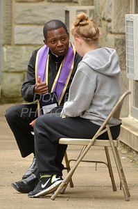 Fr. Idongesit Etim listens to confessions at St. Anthony of Padua Parish in Wilmington, Del., during the 2012 Cross Pilgrimage March 31, 2012. photo/ www.DonBlakePhotography.com