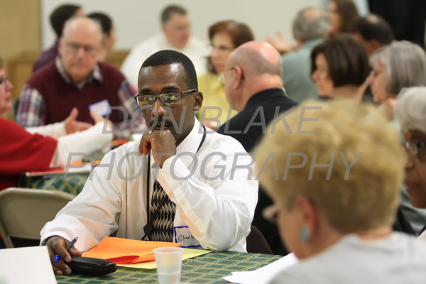 Charles listens as others at the table talk about the future needs of the Diocese during a regional deanery meeting at Holy Family in Newark, Wednesday 18, 2012. photo/ www.DonBlakepPhotography.com