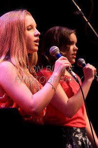 Alison Goebel (left) and Claire Moosberg sing during Ursuline Academy Coffee House at The Queen in Wilmington, Del., Sunday, April 23, 2012. photo/ Don Blake Photography