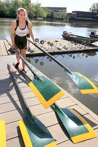 Shannon Taylor 12th grade a member of St. Mark's Girls Crew Team prepares the oars during practice on the Christiana River, Thursday, April 19, 2012. photo/ www.DonBlakepPhotography.com