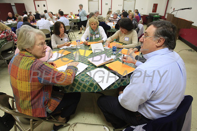 Gerri Irish and Deacon Luke Yackley talk about the future needs of the Diocese during a regional deanery meeting at Holy Family in Newark, Wednesday 18, 2012. photo/ www.DonBlakepPhotography.com