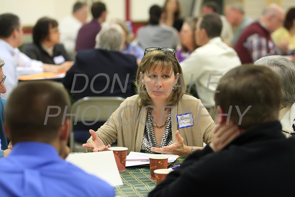 Peggy O'Donnell talks to others at the table talk about the future needs of the Diocese during a regional deanery meeting at Holy Family in Newark, Wednesday 18, 2012. photo/ www.DonBlakepPhotography.com