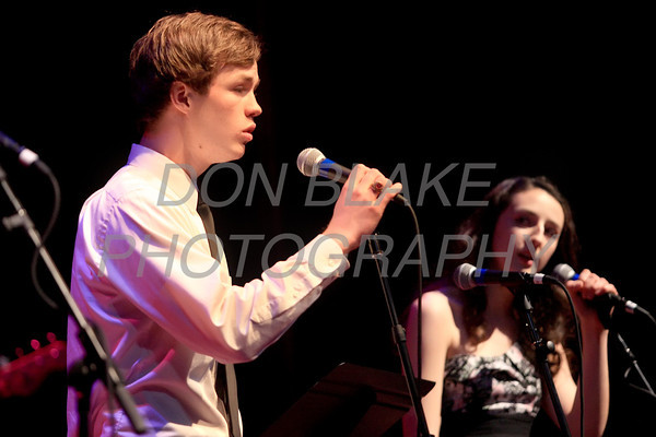 Tyler Heiss and Alecia Nippert sing a duet during Ursuline Academy Coffee House at The Queen in Wilmington, Del., Sunday, April 23, 2012. photo/ Don Blake Photography