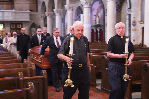 Br. MIchael Rosenello (left) and Fr. Gerard Mahoney process in with the casket at St. Anthony of Padua Church before the viewing for Fr. Roberto Balducelli, Tuesday, August 13, 2013. www.DonBlakePhotography.com