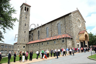 Mourners line up to pay their respects to Fr. Roberto Balducelli at St. Anthony of Padua Church, Tuesday, August 13, 2013. www.DonBlakePhotography.com
