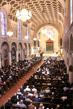 Mourners pay their respects to Fr. Roberto Balducelli during his funeral at St. Anthony of Padua Church, Wednesday, August 14, 2013. www.DonBlakePhotography.com