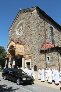 Fellow preists process into St. Anthony of Padua Church for the funeral of Fr. Roberto Balducelli, Wednesday, August 14, 2013. www.DonBlakePhotography.com