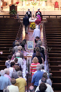 Mourners pay their respects to Fr. Roberto Balducelli at St. Anthony of Padua Church, Tuesday, August 13, 2013. www.DonBlakePhotography.com