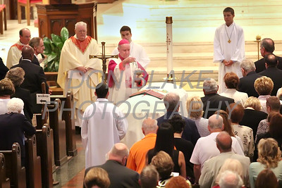 Bishop Malooly uses the incensor to blesses Fr. Roberto Balducelli during the funeral at St. Anthony of Padua Church, Wednesday, August 14, 2013. www.DonBlakePhotography.com