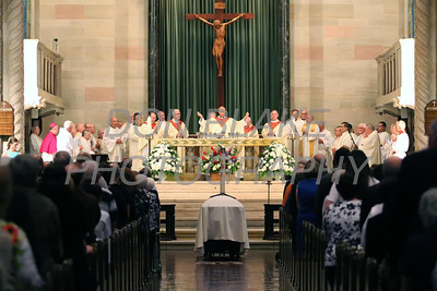 Fellow preists bless the host at St. Anthony of Padua Church during the funeral of Fr. Roberto Balducelli, Wednesday, August 14, 2013. www.DonBlakePhotography.com