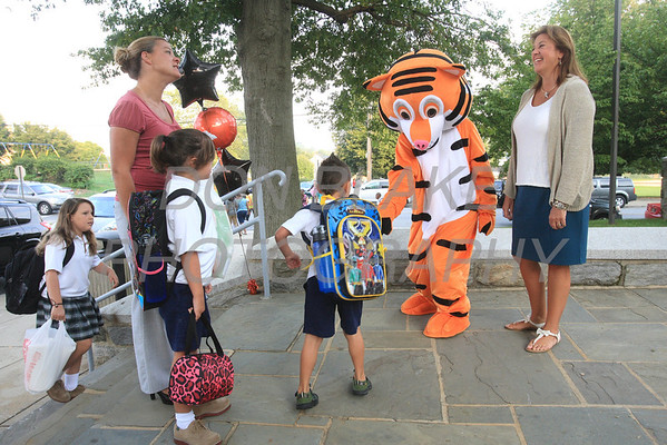 Judy White, new principal at St. Anthony School greets students with mascot Tony the Tiger (Abby White) on the first day of school. www.DonBlakePhotography.com
