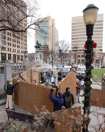 Members of St. John the Beloved set up the manger for the Creche on Rodney Square, Saturday, December 17, 2011. Don Blake Photography.com