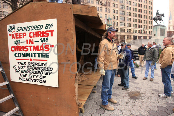 Mike Donovan coordinates as members of St. John the Beloved set up the manger for the Creche on Rodney Square, Saturday, December 17, 2011. Don Blake Photography.com