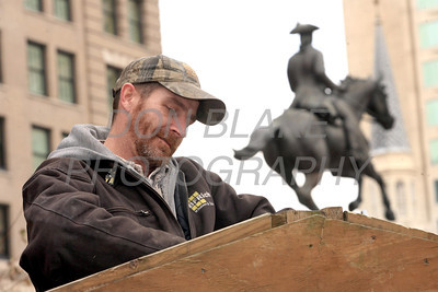 Dave Hoban helps  assemble the manger as members of St. John the Beloved set up the manger for the Creche on Rodney Square, Saturday, December 17, 2011. Don Blake Photography.com