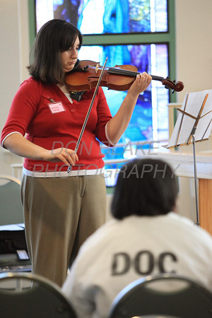 Sarah Teetsel a Franciscan Ministry plays violin before Bishop Malooly celebrates mass at the Baylor Women's Correctional Institution, New Castle, Del., Monday December 19, 2011. photo/Don Blake Photography.com