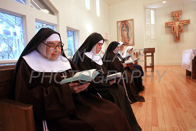 Sr. Mary Immaculate Orozco (left), Sr. Maria Elena Romero, Sr. Catalina Banuelos, Sr. Veronica DeJesus, and Sr. Maria DeLosAngels pray in the chapel at the Capuchin Poor Clares, St. Veronica Giuliani Monastery in Wilmington. photo/Don Blake Photography.com