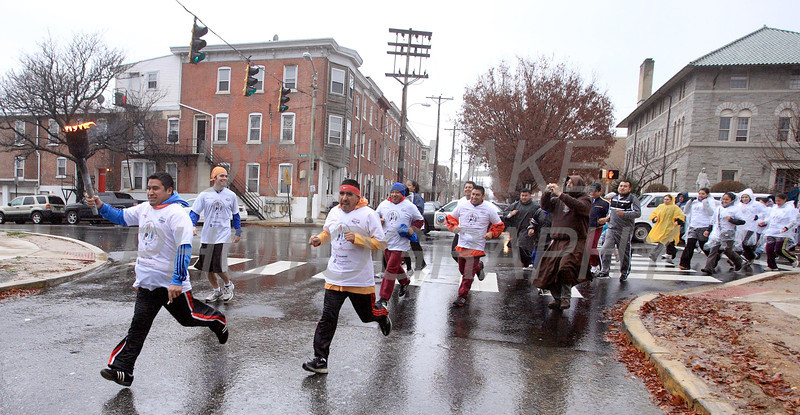 Runners participating InternationalÊGuadalupeÊTorch Run start their run at St. Paul Church Wilmington, Del., Wednesday, December 7, 2011. The pilgrimage is carried out in a relay style from Mexico City, Mexico to New York City. Runners will carry the torch more than 3,800 miles from Mexico and are scheduled to arrive in New York Dec. 12, the feast of Our Lady of Guadalupe. photo/Don Blake Photography.com
