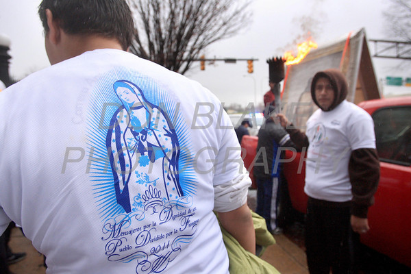 Runners participating InternationalÊGuadalupeÊTorch Run prepare to start their run at St. Paul Church, Wilmington, Del., Wednesday, December 7, 2011. The pilgrimage is carried out in a relay style from Mexico City, Mexico to New York City. Runners will carry the torch more than 3,800 miles from Mexico and are scheduled to arrive in New York Dec. 12, the feast of Our Lady of Guadalupe. photo/Don Blake Photography.com