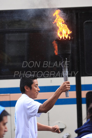 Runners participating InternationalÊGuadalupeÊTorch Run carry the torch along 4th Street in Wilmington, Wednesday, December 7, 2011. The pilgrimage is carried out in a relay style from Mexico City, Mexico to New York City. Runners will carry the torch more than 3,800 miles from Mexico and are scheduled to arrive in New York Dec. 12, the feast of Our Lady of Guadalupe. photo/Don Blake Photography.com