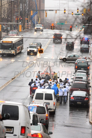 Runners participating InternationalÊGuadalupeÊTorch Run carry the torch along 4th Street in Wilmington, Del., Wednesday, December 7, 2011. The pilgrimage is carried out in a relay style from Mexico City, Mexico to New York City. Runners will carry the torch more than 3,800 miles from Mexico and are scheduled to arrive in New York Dec. 12, the feast of Our Lady of Guadalupe. photo/Don Blake Photography.com