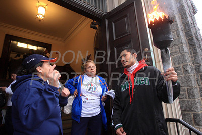 Coordinators of the InternationalÊGuadalupeÊTorch Run talk about the route the torch is to run before the start of run at St. Paul Church, Wilmington, Del., Wednesday, December 7, 2011. The pilgrimage is carried out in a relay style from Mexico City, Mexico to New York City. Runners will carry the torch more than 3,800 miles from Mexico and are scheduled to arrive in New York Dec. 12, the feast of Our Lady of Guadalupe. photo/Don Blake Photography.com
