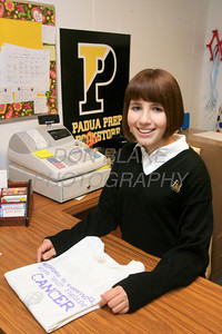 Padua student Pearce Quesenberry grade 9 with one of a shirts from her foundation that are available at Pauda's bookstore. photo/Don Blake Photography.com