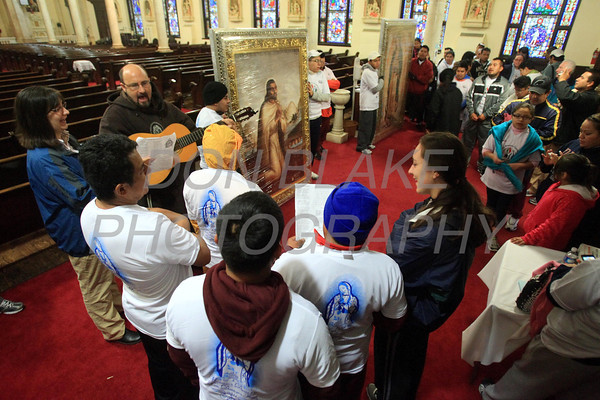 Runners participating InternationalÊGuadalupeÊTorch Run sing and pray as they prepare to start their run at St. Paul Church, Wednesday, December 7, 2011. The pilgrimage is carried out in a relay style from Mexico City, Mexico to New York City. Runners will carry the torch more than 3,800 miles from Mexico and are scheduled to arrive in New York Dec. 12, the feast of Our Lady of Guadalupe. photo/Don Blake Photography.com