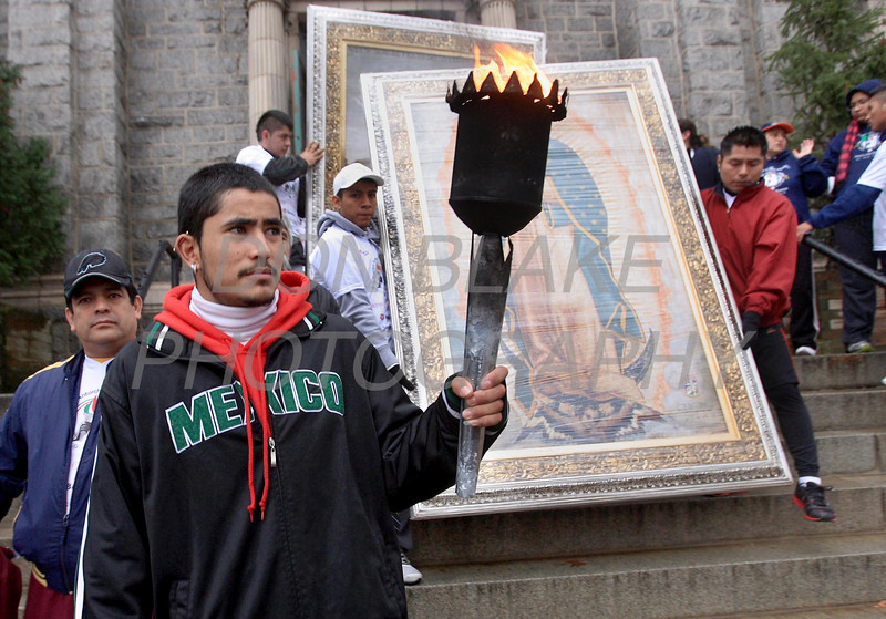 Runners participating InternationalÊGuadalupeÊTorch Run prepare to start their run at St. Paul Church, Wednesday, December 7, 2011. The pilgrimage is carried out in a relay style from Mexico City, Mexico to New York City. Runners will carry the torch more than 3,800 miles from Mexico and are scheduled to arrive in New York Dec. 12, the feast of Our Lady of Guadalupe. photo/Don Blake Photography.com