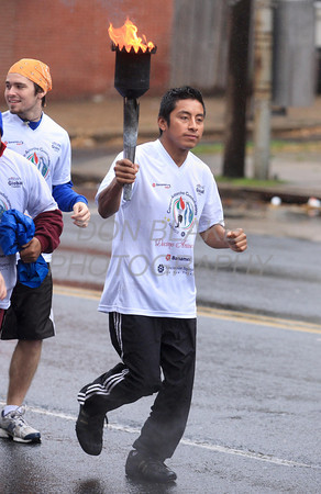 Runners participating InternationalÊGuadalupeÊTorch Run carry the torch along 4th Street in Wilmington after leaving St. Paul Church,  Wilmington, Del., Wednesday, December 7, 2011. The pilgrimage is carried out in a relay style from Mexico City, Mexico to New York City. Runners will carry the torch more than 3,800 miles from Mexico and are scheduled to arrive in New York Dec. 12, the feast of Our Lady of Guadalupe. photo/Don Blake Photography.com